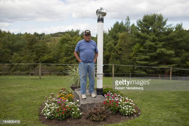 Mike Leighton 68 years stands next to a venting pipe for a contaminated water well September 10 2012 at his home in Granville Summit Pennsylvania...