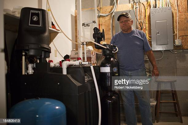 Mike Leighton 68 years stands next to a water filtration system for his contaminated water well September 10 2012 at his home in Granville Summit...
