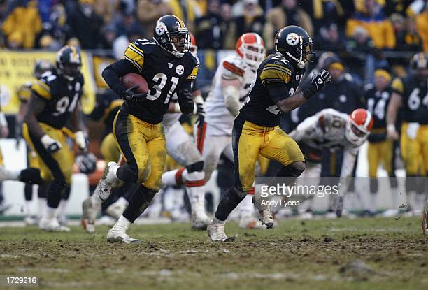 Mike Logan of the Pittsburgh Steelers returns an interception 14 yards to the Steelers 39 yardline at 750 of the third quarter of the AFC Wild Card...