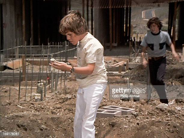 Mike Lookinland as Bobby Brady finding the tiki doll in THE BRADY BUNCH episode Hawaii Bound Christopher Knight as Peter Brady is in the background...