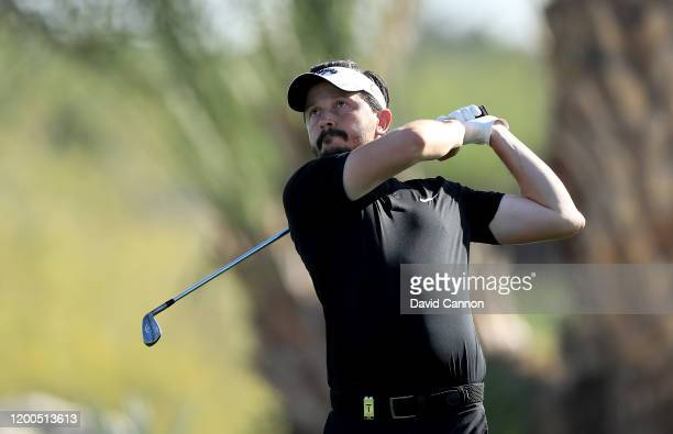 Mike LorenzoVera of France plays his second shot on the 17th hole during the final round of the Abu Dhabi HSBC Championship at Abu Dhabi Golf Club on...