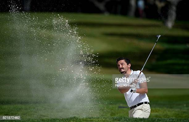 Mike LorenzoVera of France plays his third shot on the par four 16th hole during the third round of the Open de Espana at Valderrama Golf Club on...