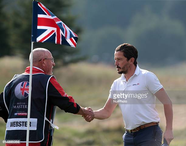 Mike LorenzoVera shanks hands with Steve Webster Caddie during The British Masters 2016 supported by SkySports second round at The Grove Golf Course...