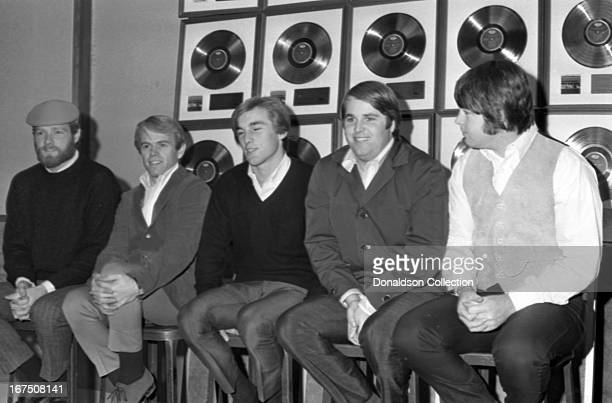 "Mike Love, Al Jardine, Dennis Wilson, Carl Wilson, Brian Wilson of the rock and roll group ""The Beach Boys"" during an interview in November 1965 in..."