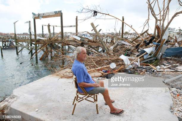 Mike Lowe, who is half blind and suffers from diabetes, rests in the spot where he rests everyday in Great Abaco Island on September 6, 2019. In...