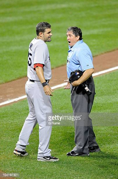 Mike Lowell of the Boston Red Sox argues with home plate umpire Ed Rapuano after being called out on strikes against the Baltimore Orioles at Camden...