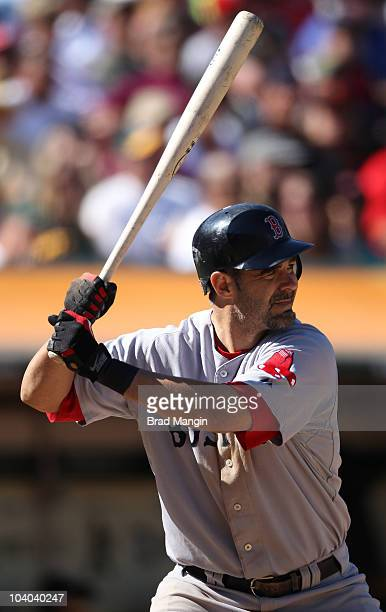 Mike Lowell of the Boston Red Sox bats against the Oakland Athletics during the game at the OaklandAlameda County Coliseum on September 12 2010 in...