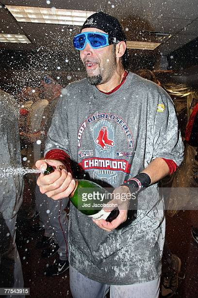 Mike Lowell of the Boston Red Sox celebrates with champagne in the locker room after winning Game Four by a score of the 43 to win the 2007 Major...