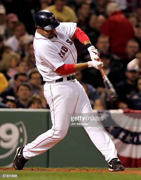 Mike Lowell of the Boston Red Sox hits a double in the second inning against the Toronto Blue Jays on April 12, 2006 at Fenway Park in Boston,...