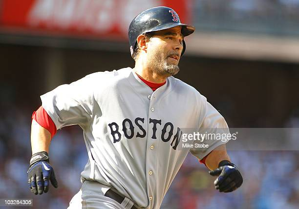 Mike Lowell of the Boston Red Sox hits an RBI double in the secondinning against the New York Yankees on August 7 2010 at Yankee Stadium in the Bronx...