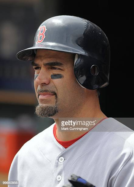 Mike Lowell of the Boston Red Sox looks on from the dugout against the Detroit Tigers during the game at Comerica Park on May 16 2010 in Detroit...