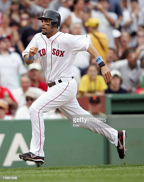 Mike Lowell of the Boston Red Sox scores a run in the third inning against the San Francisco Giants on June 17 2007 at Fenway Park in Boston...