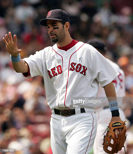Mike Lowell of the Boston Red Sox signals to the dugout before the game against the San Francisco Giants on June 17 2007 at Fenway Park in Boston...