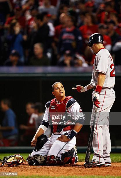 Mike Lowell of the Boston Red Sox talks to catcher Victor Martinez of the Cleveland Indians after Manny Ramirez thought he hit a home run in the...