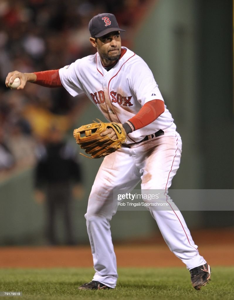 Mike Lowell #25 of the Boston Red Sox throws to first base against the Colorado Rockies during Game Two of the 2007 Major League Baseball World Series at Fenway Park on October 25, 2007 in Boston, Massachusetts.