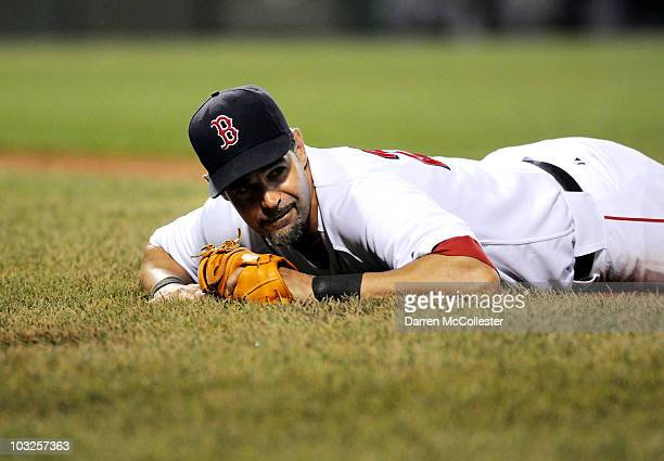 Mike Lowell of the Boston Red Sox watches a ball go down the first base line against the Cleveland Indians August 5 2010 at Fenway Park in Boston...