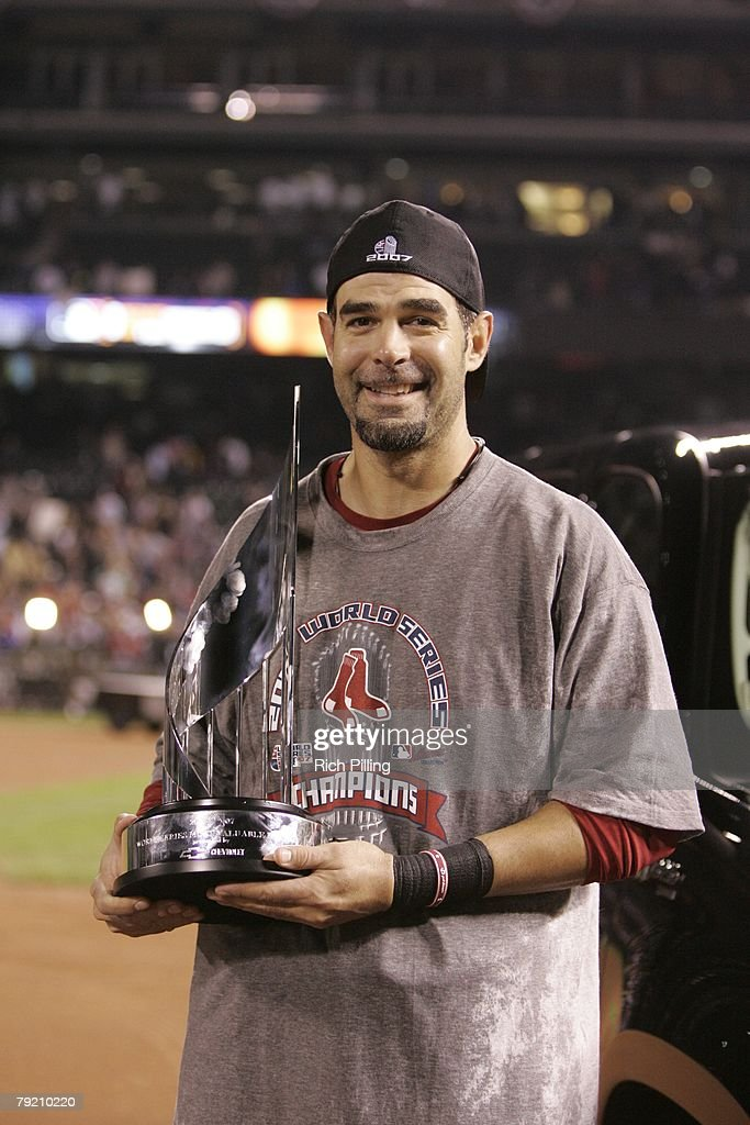 Mike Lowell the Boston Red Sox holds the MVP trophy during Game Four of the 2007 World Series against the Colorado Rockies on October 28, 2007 at Coors Field in Denver, Colorado. The Red Sox defeated the Rockies 4-3.