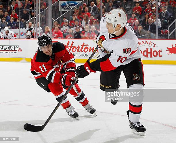 Mike Lundin of the Ottawa Senators and Stephen Gionta of the New Jersey Devils skate for position during the game at the Prudential Center on...