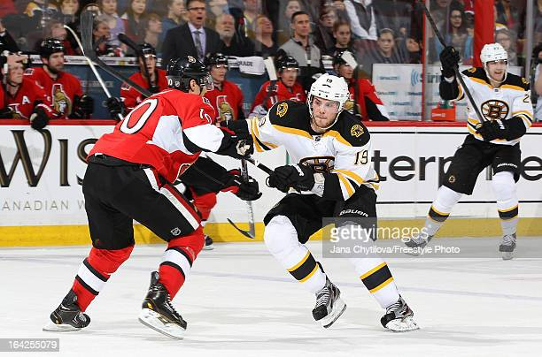 Mike Lundin of the Ottawa Senators defends against a charging Tyler Seguin of the Boston Bruins during an NHL game at Scotiabank Place on March 21...