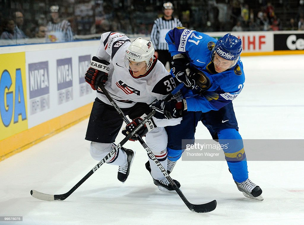 Mike Lundin (L) of United States battles for the puck with Evgeni Bumagin (R) of Kazakhstan during the IIHF World Championship final round match between USA and Kazakhstan at Lanxess Arena on May 15, 2010 in Cologne, Germany.