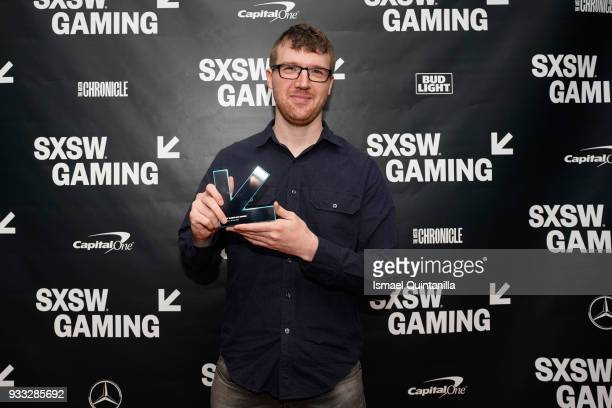 Mike Lunn poses with the award for Game of the Year backstage at SXSW Gaming Awards during SXSW at Hilton Austin Downtown on March 17 2018 in Austin...