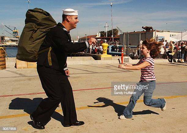 Mike MacCarthy prepares to greet his daughter Mikayla as she runs to hug him as he arrives from the USS Pelelieu at the Naval Station March 9 2004 in...