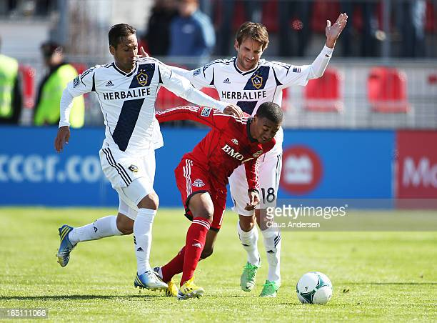 Mike Magee and Marcelo Sarvas of the Los Angeles Galaxy play against Robert Earnshaw of the Toronto FC in an MLS game on March 30 2013 at BMO Field...