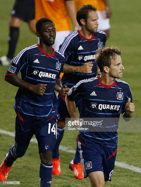 Mike Magee and Patrick Nyarko of the Chicago Fire celebrate after Magee scored a second half goal against the Houston Dynamo at BBVA Compass Stadium...