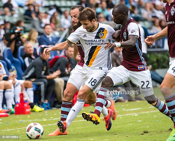 Mike Magee of Los Angeles Galaxy battles Michael Azira of Colorado Rapids during Los Angeles Galaxy's MLS Playoff Semifinal match against Colorado...