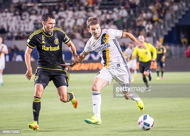 Mike Magee of Los Angeles Galaxy battles Michael Parkhurst of Columbus Crew during Los Angeles Galaxy's MLS match against Columbus Crew at the...