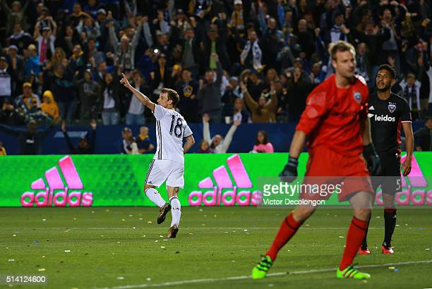 Mike Magee of Los Angeles Galaxy celebrates his goal as goalkeeper Andrew Dykstra and defender Sean Franklin of DC United look on during the second...
