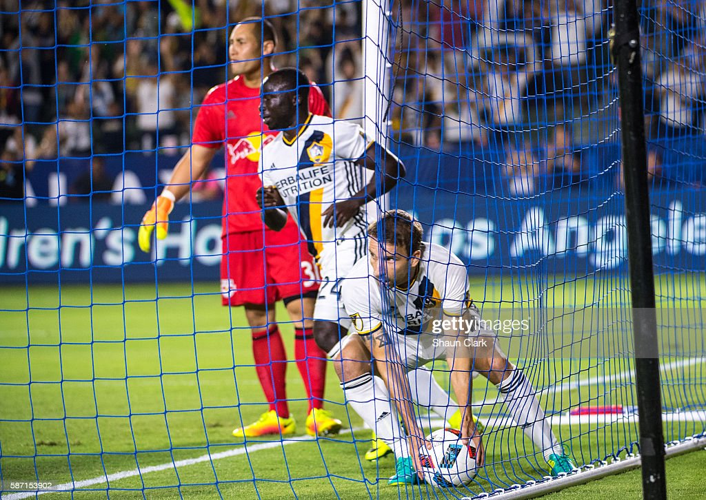 Mike Magee #18 of Los Angeles Galaxy retrieves the ball from the back of the net after scoring a goal during Los Angeles Galaxy's MLS match against the New York Red Bulls at the StubHub Center on August 7, 2016 in Carson, California. The match ended 2-2