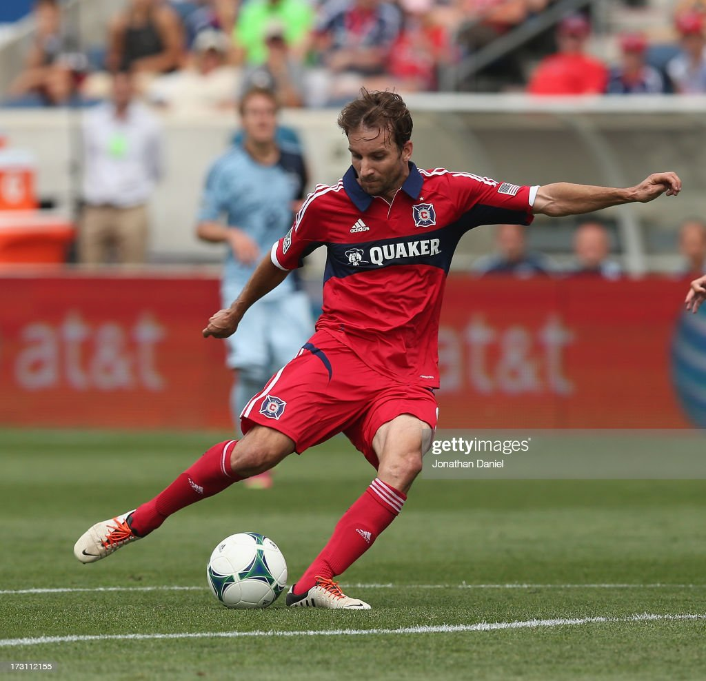 Mike Magee #9 of the Chicago Fire scores a first half goal against Sporting Kansas City during an MLS match at Toyota Park on July 7, 2013 in Bridgeview, Illinois.