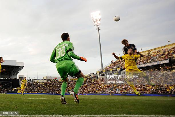 Mike Magee of the Los Angeles Galaxy and Sebastian Miranda of the Columbus Crew battle for control of the ball in front of goalkeeper Andy Gruenebaum...