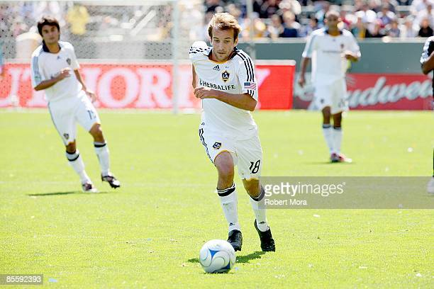 Mike Magee of the Los Angeles Galaxy attacks the defense of DC United during the MLS game at Home Depot Center on March 22 2009 in Carson California