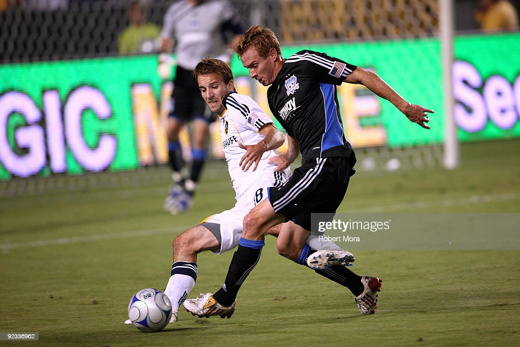 Mike Magee #18 of the Los Angeles Galaxy battles Chris Leitch #4 of the San Jose Earthquakes for a loose ball during their MLS game at The Home Depot Center on October 24, 2009 in Carson, California.