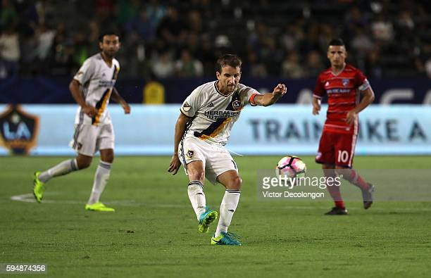 Mike Magee of the Los Angeles Galaxy crosses during the first half against FC Dallas in the semifinal of the 2016 US Open Cup at StubHub Center on...