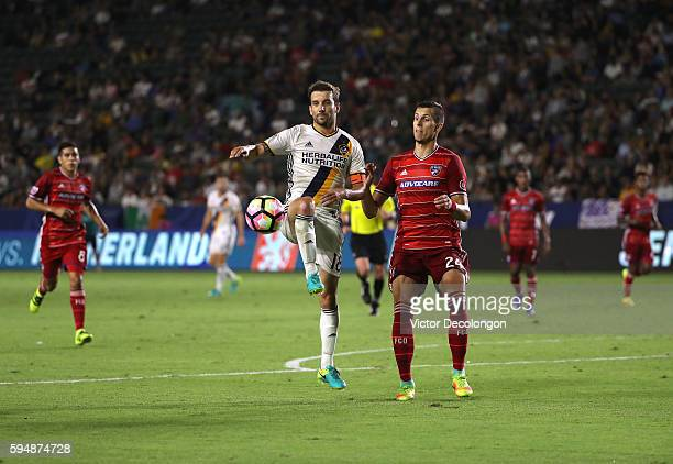 Mike Magee of the Los Angeles Galaxy looks to play the ball as Matt Hedges of FC Dallas looks on in the second half during the semifinal of the 2016...