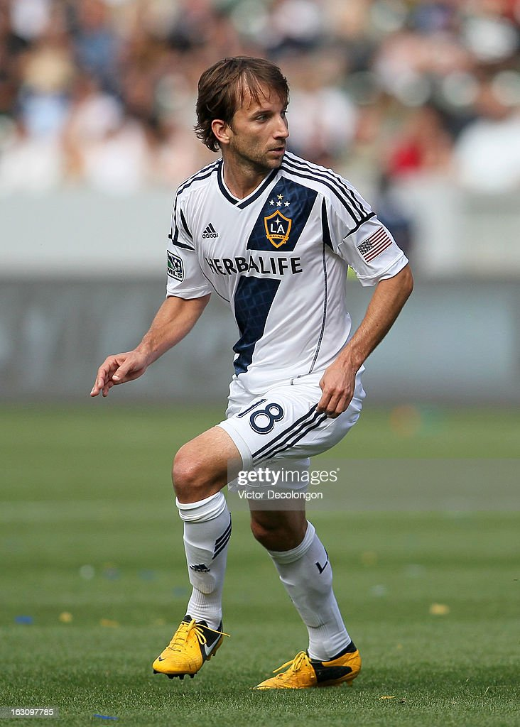 Mike Magee #18 of the Los Angeles Galaxy turns to pursue the play during the MLS match against the the Chicago Fire at The Home Depot Center on March 3, 2013 in Carson, California. The Galaxy defeated the Fire 4-0.