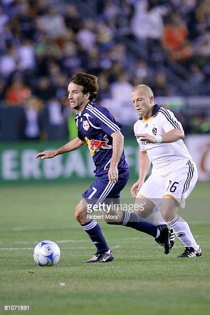 Mike Magee pushes the ball past Joe Franchino of the Los Angeles Galaxy during the MLS game against the New York Red Bulls at Home Depot Center on...