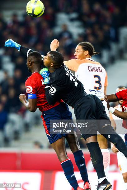 Mike MAIGNAN of Lille Ibrahim Amadou of Lille and Daniel Congre of Montpellier during the Ligue 1 match between Lille OSC and Montpellier Herault SC...