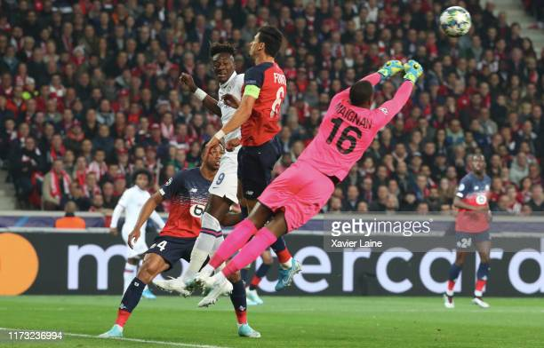 Mike Maignan of Lille LOSC kick the ball over Tammy Abraham of Chelsea FC during the UEFA Champions League group H match between Lille OSC and...