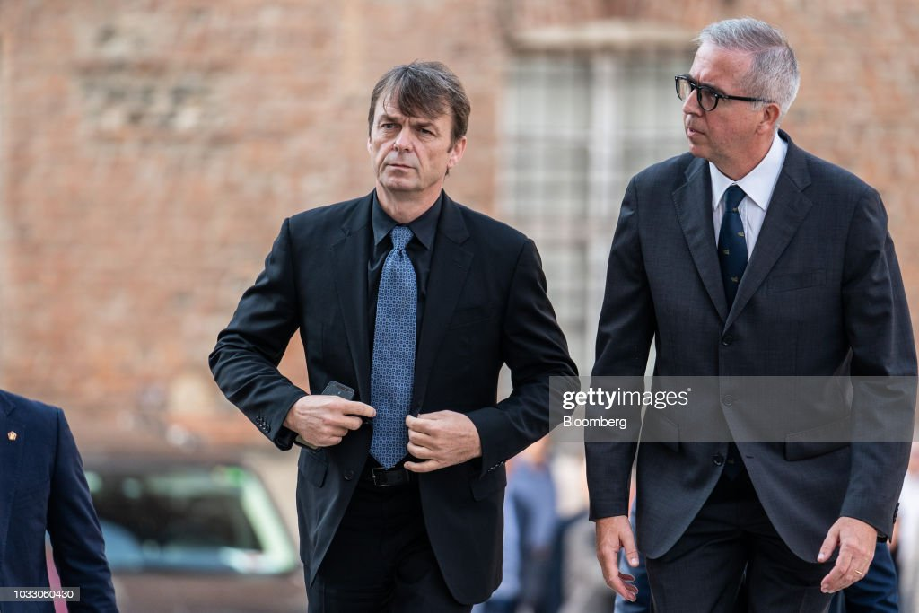 Mike Manley, chief executive officer of Fiat Chrysler Automobiles NV, right, arrives for a memorial service for former Fiat Chrysler Automobiles NV chief executive officer Sergio Marchionne at the cathedral in Turin, Italy, on Friday, Sept. 14, 2018. Marchionne, the architect of the automaker's dramatic turnaround died, aged 66, on Wednesday, July 25, 2018. Photographer: Federico Bernini/Bloomberg via Getty Images