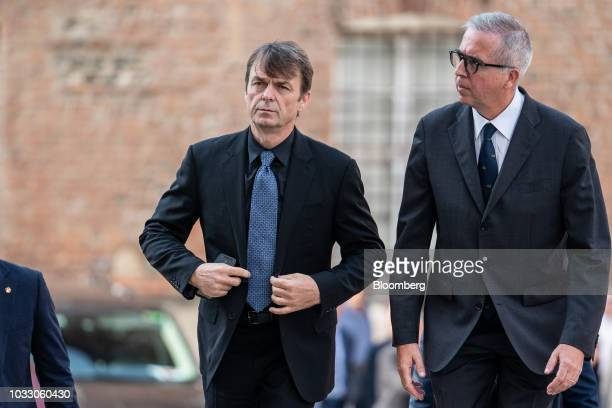 Mike Manley chief executive officer of Fiat Chrysler Automobiles NV right arrives for a memorial service for former Fiat Chrysler Automobiles NV...