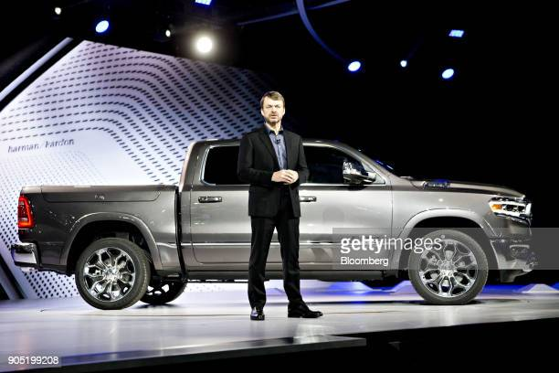 Mike Manley head of the Ram Jeep Brand for FCA US LLC speaks in front of a Fiat Chrysler Automobiles NV 2019 Ram 1500 pickup truck during the 2018...