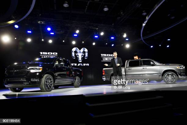 Mike Manley head of the Ram Jeep Brand for FCA US LLC speaks while standing in front of Fiat Chrysler Automobiles NV 2019 Ram 1500 pickup trucks...