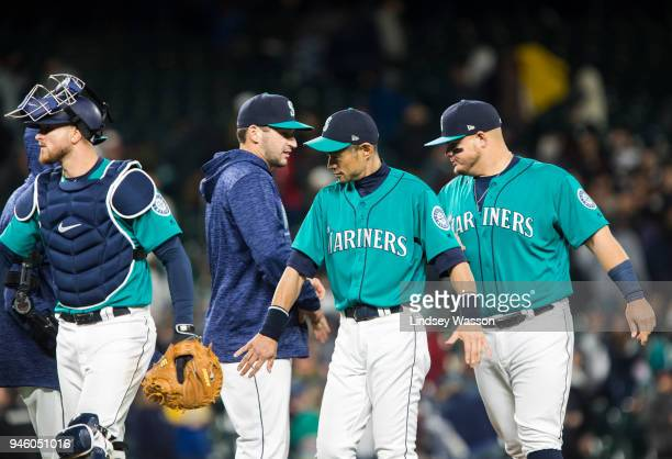 Mike Marjama of the Seattle Mariners left Mike Zunino Ichiro Suzuki and Daniel Vogelbach celebrate their win against the Oakland Athletics at Safeco...