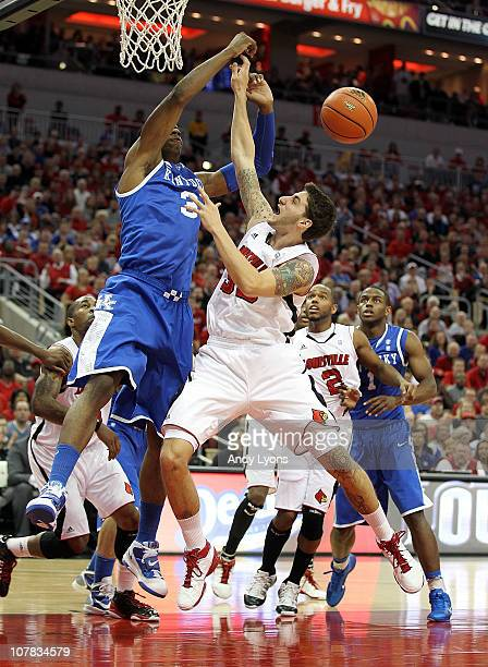Mike Marra of the Louisville Cardinals has his shot blocked by Terrence Jones of the Kentucky Wildcats during the game at the KFC Yum Center on...