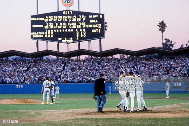 Mike Marshall of the Los Angeles Dodgers celebrates with teammates Franklin Stubbs and Mikey Hatcher after hitting a three run home run during the...