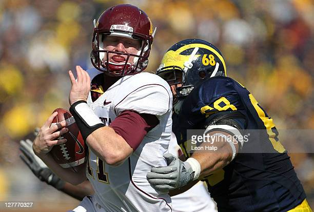 Mike Martin of the Michigan Wolverines sacks Max Shortell of the Minnesota Golden Gophers during the second quarter of the game at Michigan Stadium...